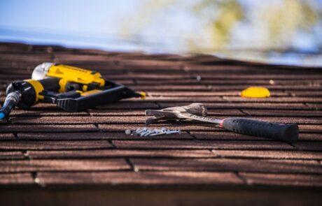shingled roof with hammer and nail gun