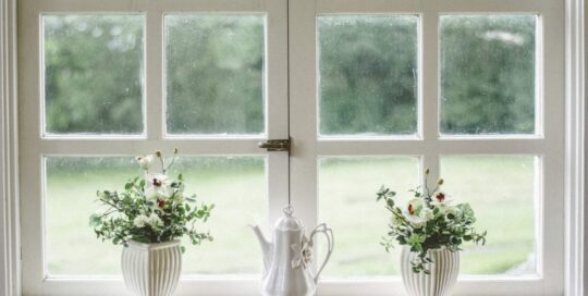 White window with two vases and teapot on sill