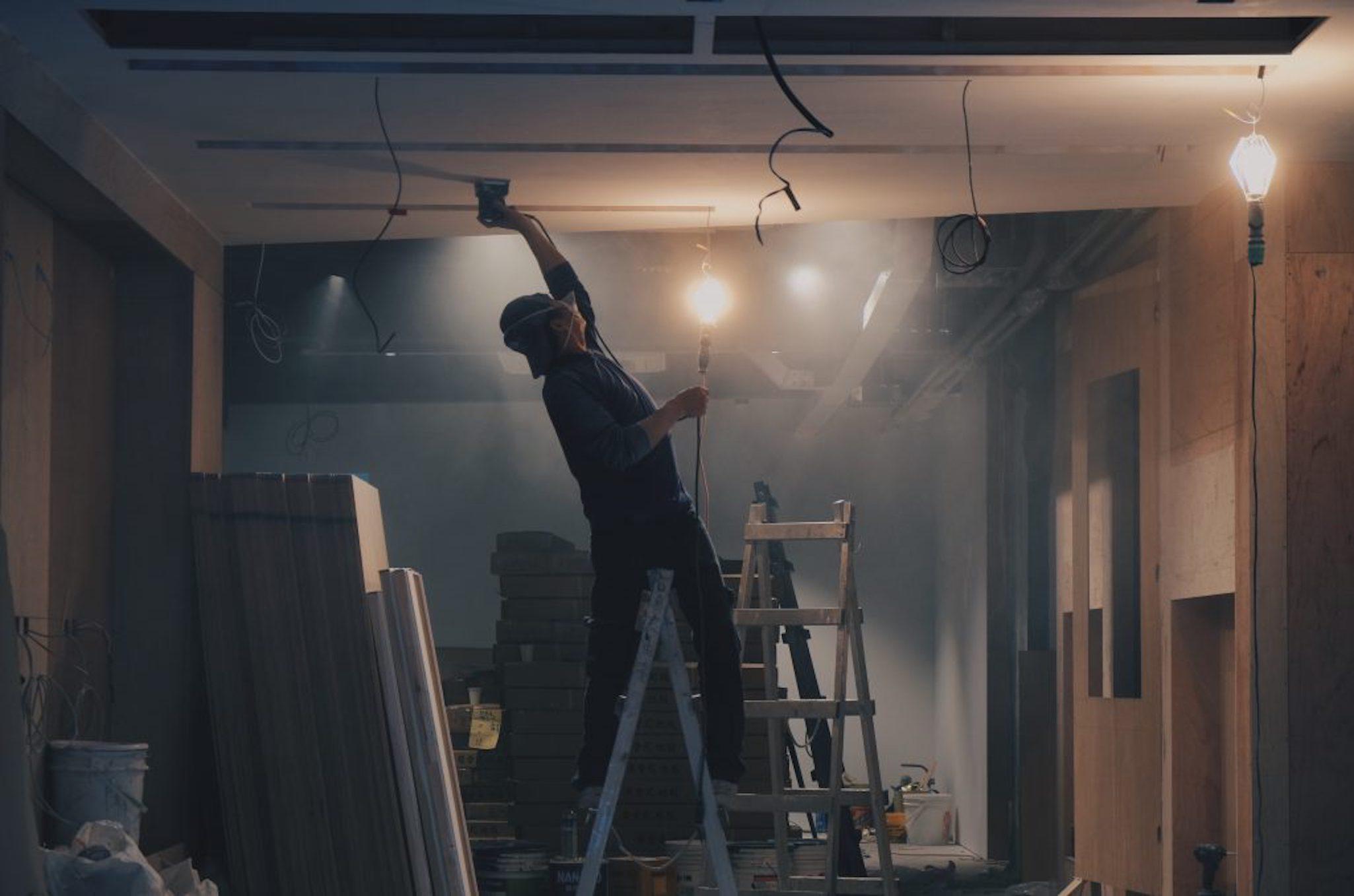 Contractor Working In Dark Room