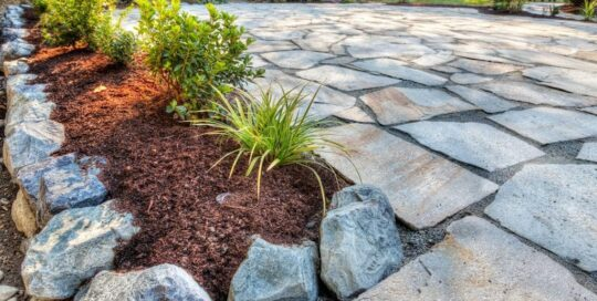 natural stone patio surrounded by plants