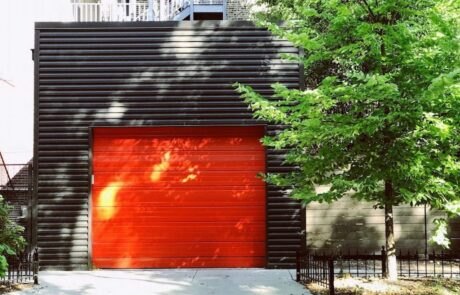 orange garage door on black building