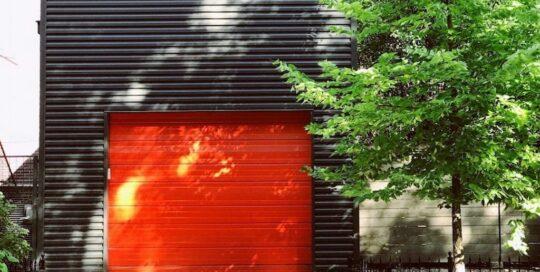 orange garage door on black building