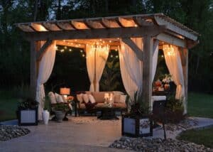 pergola with string lights and patio furniture
