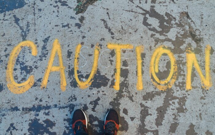 Caution Painted On The Ground