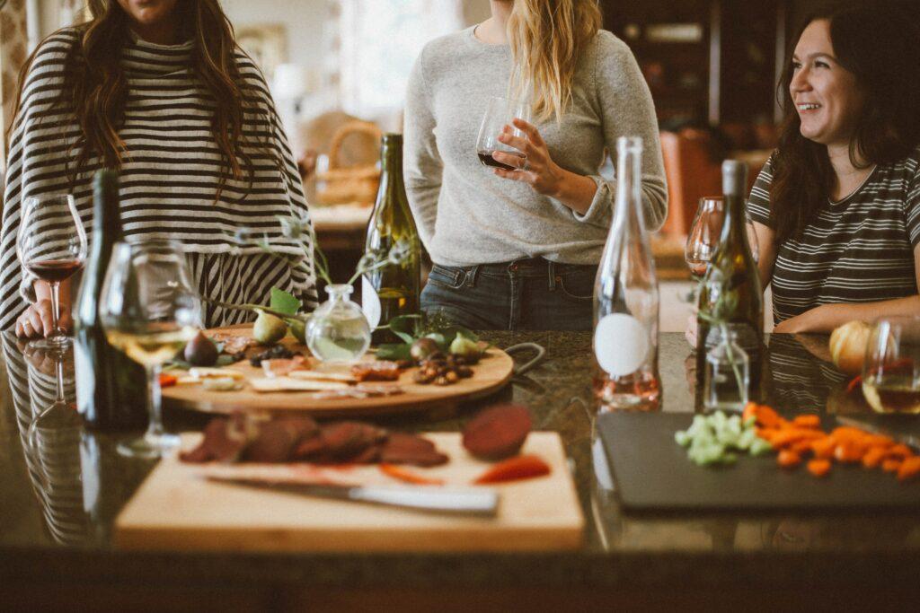 Women Standing Around Dinner Table