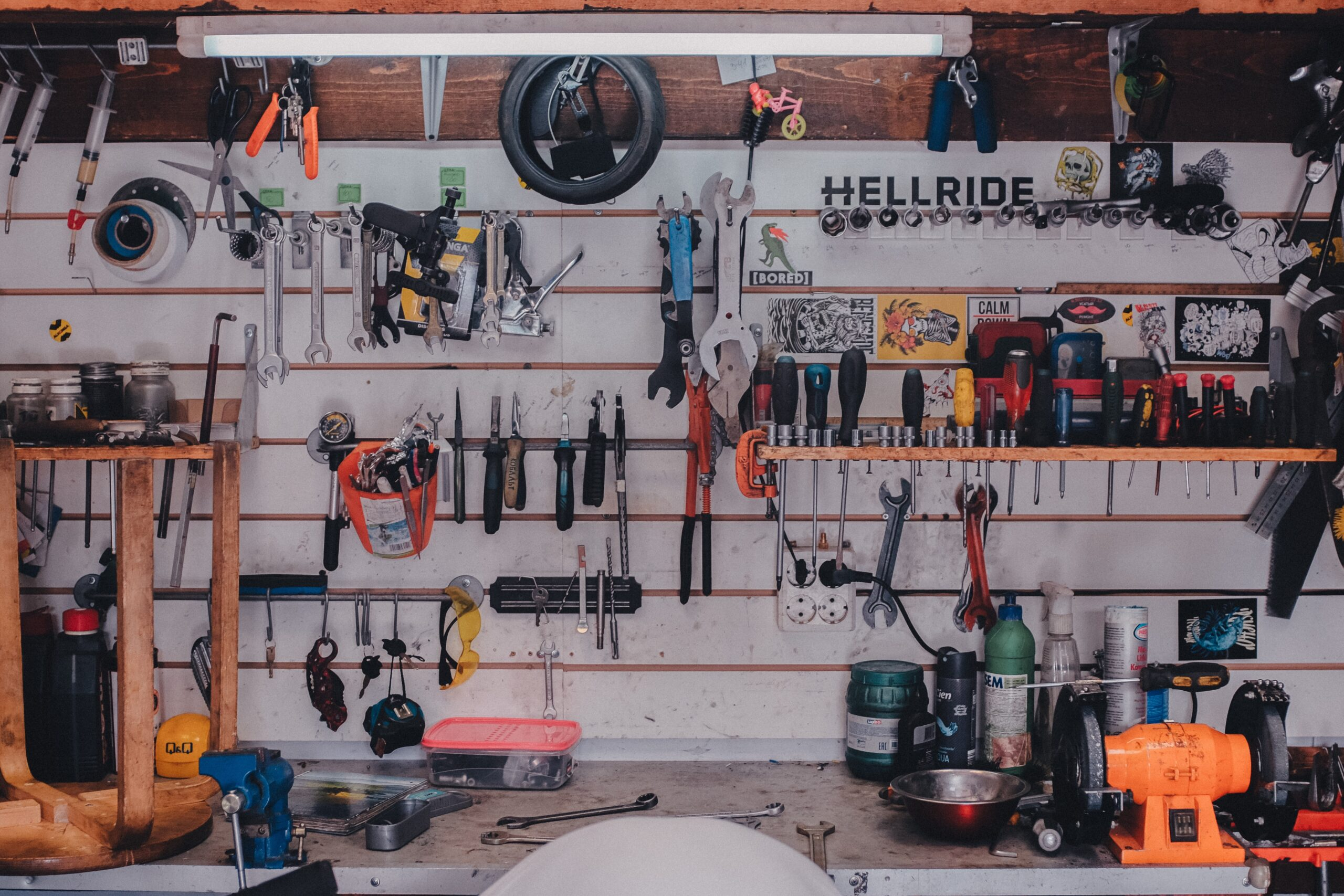 mechanical tools on shelf and on wall