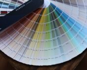 paint color cards, so many of them, fanned out so you can see hundreds