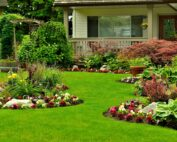 picture of house with beautiful flowerbeds